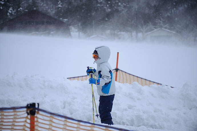 "Riding the ""Sankiddo"" as wind whips up the background -- Makino Ski Area -- Takashima, Shiga, Japan -- Copyright 2010 Jeffrey Friedl, http://regex.info/blog/"