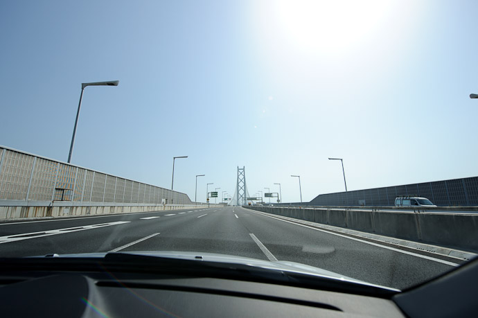 Approach ( last shot through the windshield before sticking the camera outside ) -- Akashi Straights Bridge -- Kobe, Hyogo, Japan -- Copyright 2010 Jeffrey Friedl, http://regex.info/blog/