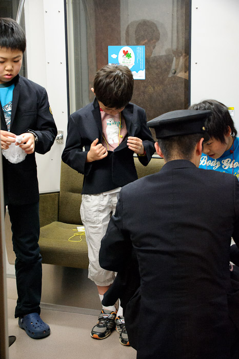 Suiting Up -- KidZania -- Nishinomiya, Hyogo, Japan -- Copyright 2010 Jeffrey Friedl, http://regex.info/blog/