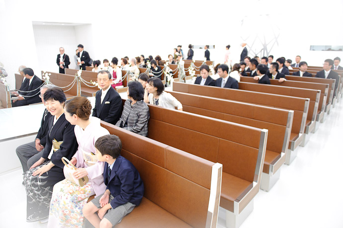Getting Seated Anthony, Fumie, and Fumie's folks in the front row ( I'd overexposed the shot in camera, and took the vibe further in Lightroom ) -- Wedding of Shogo and Namiko -- Nagoya, Aichi, Japan -- Copyright 2010 Jeffrey Friedl, http://regex.info/blog/