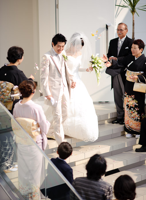 Exiting the Chapel to a shower of flower petals -- Wedding of Shogo and Namiko -- Nagoya, Aichi, Japan -- Copyright 2010 Jeffrey Friedl, http://regex.info/blog/