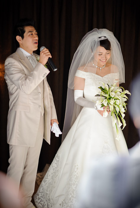 Shogo Makes a Short Speech while Namiko simply radiates ( By the way, a different — and amazing — version of this photo appears here ) -- Wedding of Shogo and Namiko Matsunaka -- Nagoya, Aichi, Japan -- Copyright 2010 Jeffrey Friedl, http://regex.info/blog/