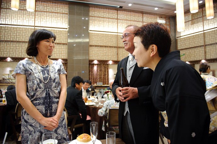 Parents of the Bride make the rounds, talking to the groom's cousin -- Wedding of Shogo and Namiko -- Nagoya, Aichi, Japan -- Copyright 2010 Jeffrey Friedl, http://regex.info/blog/
