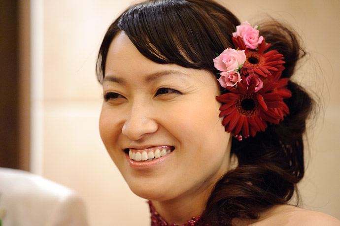Namiko ( she was really too close for a good portrait with the 125mm Voigtländer; if I would have had the time, I would have switched to the Nikkor 85mm f/1.4 for this ) -- Wedding of Shogo and Namiko -- Nagoya, Aichi, Japan -- Copyright 2010 Jeffrey Friedl, http://regex.info/blog/