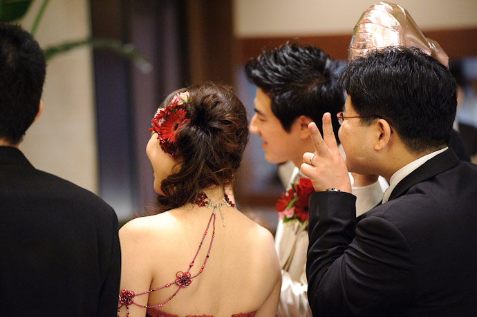 More Mingling ( he's giving a peace sign, not donkey ears ) -- Wedding of Shogo and Namiko -- Nagoya, Aichi, Japan -- Copyright 2010 Jeffrey Friedl, http://regex.info/blog/