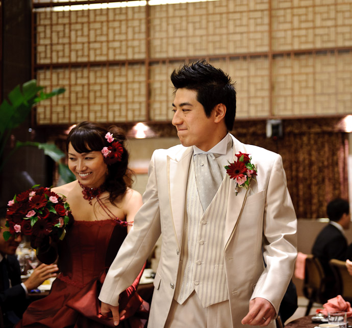 Shogo Exits With His Bride I think this ranks up there with the candid bride portrait as the best picture of the event because Shogo's radiating confidence is so full of awesome -- Wedding of Shogo and Namiko -- Nagoya, Aichi, Japan -- Copyright 2010 Jeffrey Friedl, http://regex.info/blog/