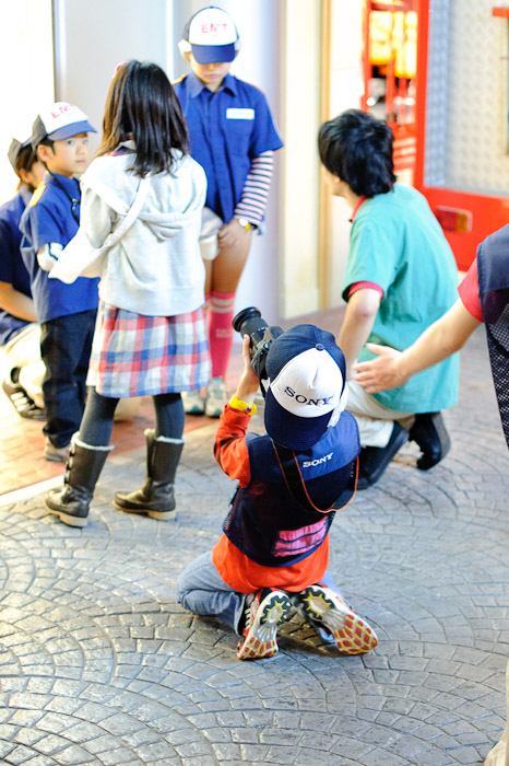 Anthony Grabbing the Action -- Kidzania -- Nishinomiya, Hyogo, Japan -- Copyright 2010 Jeffrey Friedl, http://regex.info/blog/