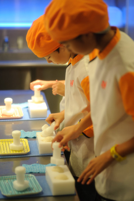 About To Press Rice In Molds -- Kidzania -- Nishinomiya, Hyogo, Japan -- Copyright 2010 Jeffrey Friedl, http://regex.info/blog/