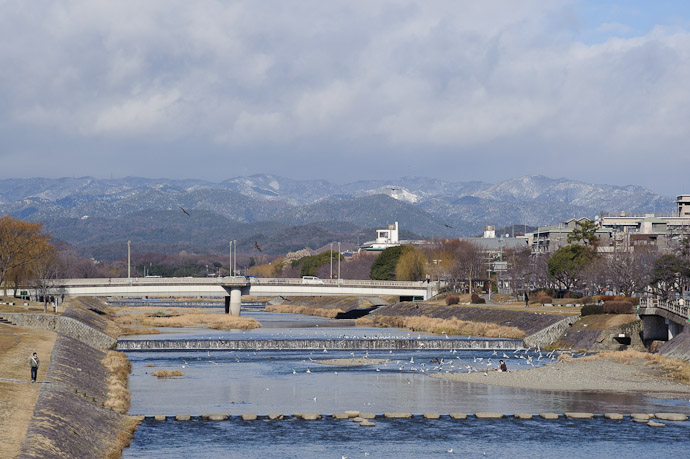 Blustery Mountains looking north up the Kamo river, from Nijo Street Kyoto Japan -- Copyright 2011 Jeffrey Friedl, http://regex.info/blog/