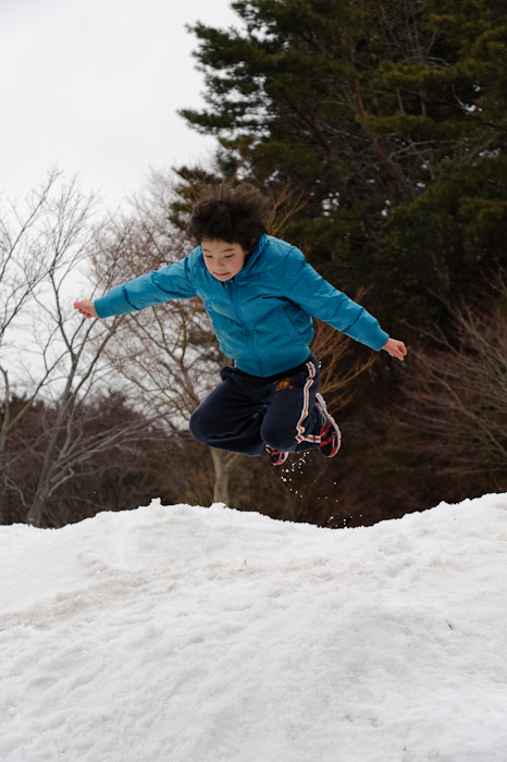 Leaping Off the Huge Snow Pile -- Hieizan Driveway -- Shiga, Japan -- Copyright 2011 Jeffrey Friedl, http://regex.info/blog/