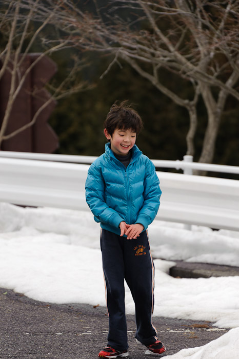 Happy About Something probably having gotten me with a snowball -- Hieizan Driveway -- Shiga, Japan -- Copyright 2011 Jeffrey Friedl, http://regex.info/blog/