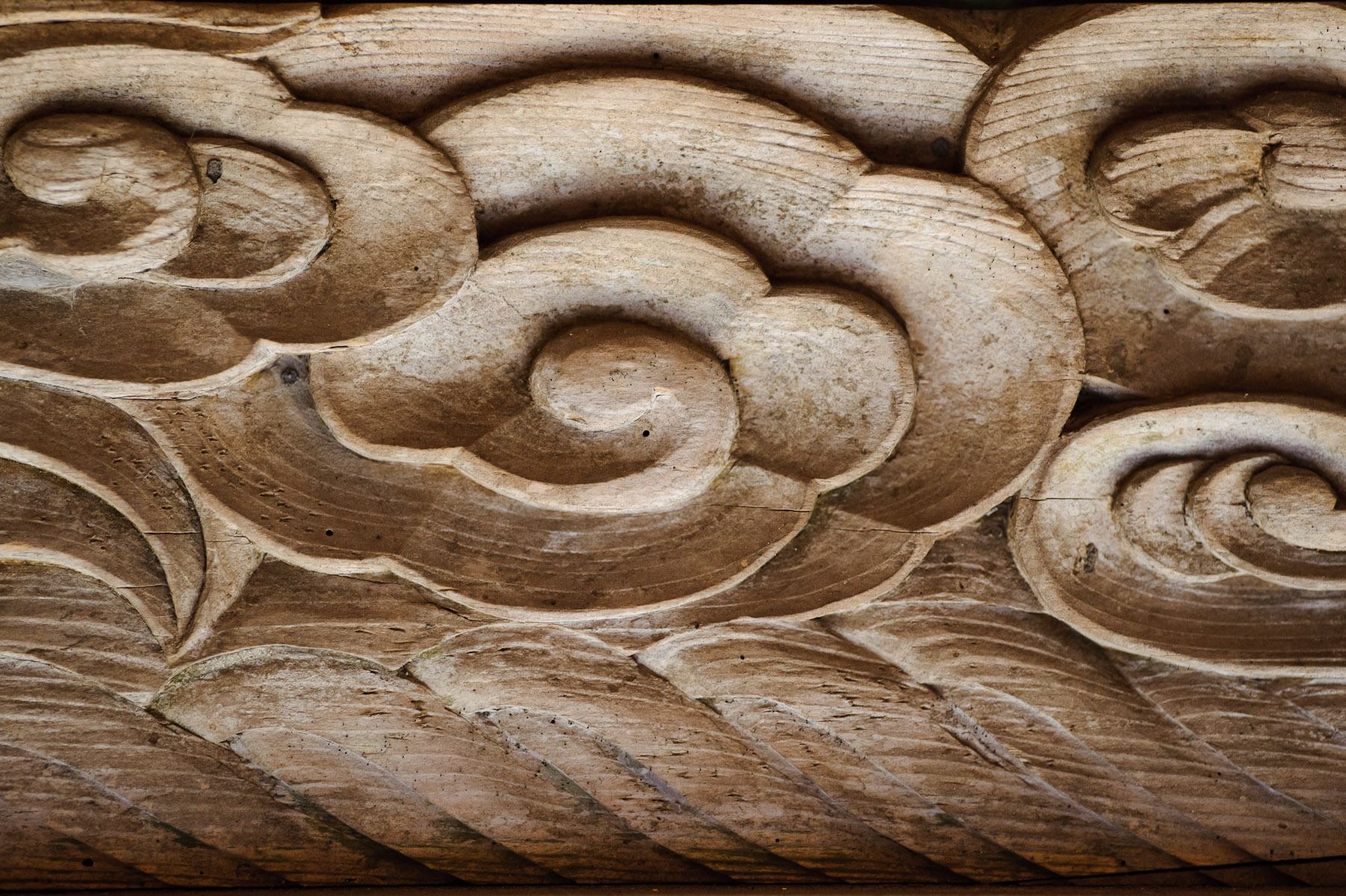 Jeffrey friedl s simple wood carving on a rural shrine s gate