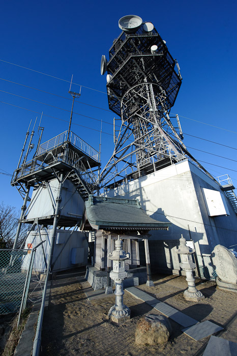 Only in Japan small shrine and large communications tower at the top of a mountain -- Mt. Takanawa (高縄山) -- Matsuyama, Ehime, Japan -- Copyright 2011 Jeffrey Friedl, http://regex.info/blog/