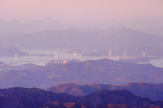 Bridge 15 Miles Away at 380mm again, heavily processed in Lightroom to cut the haze -- Mt. Takanawa (高縄山) -- Matsuyama, Ehime, Japan -- Copyright 2011 Jeffrey Friedl, http://regex.info/blog/