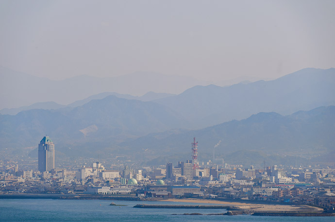 Layers and Layers of Mountains the tall building at left is our hotel -- Imabari, Ehime, Japan -- Copyright 2011 Jeffrey Friedl, http://regex.info/blog/