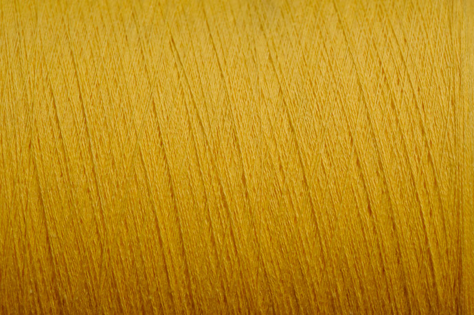 desktop background image of a close-up view of a large spool of yellow thread, at the Towel Museum in Imabari, Japan -- Golden Yellow -- Imabari, Ehime, Japan -- Copyright 2011 Jeffrey Friedl, http://regex.info/blog/