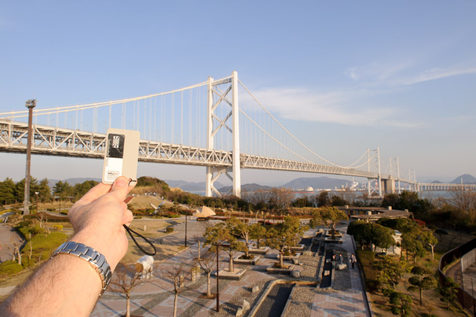 Just Checking the Light with the 1,723-meter Minami Bisan-Seto Bridge in the background between Honshu and Shikoku, Japan -- Great Seto Bridge -- Sakaide, Kagawa, Japan -- Copyright 2011 Jeffrey Friedl, http://regex.info/blog/
