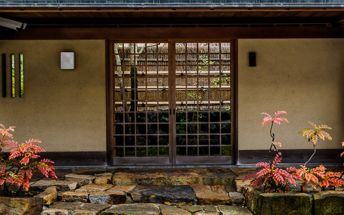 desktop background image of the stylish entrance to a private house in Kyoto, Japan  --  Entrance to someone's House in Kyoto  --  Copyright 2011 Jeffrey Friedl, http://regex.info/blog/  --  This photo is licensed to the public under the Creative Commons Attribution-NonCommercial 3.0 Unported License http://creativecommons.org/licenses/by-nc/3.0/ (non-commercial use is freely allowed if proper attribution is given, including a link back to this page on http://regex.info/ when used online)