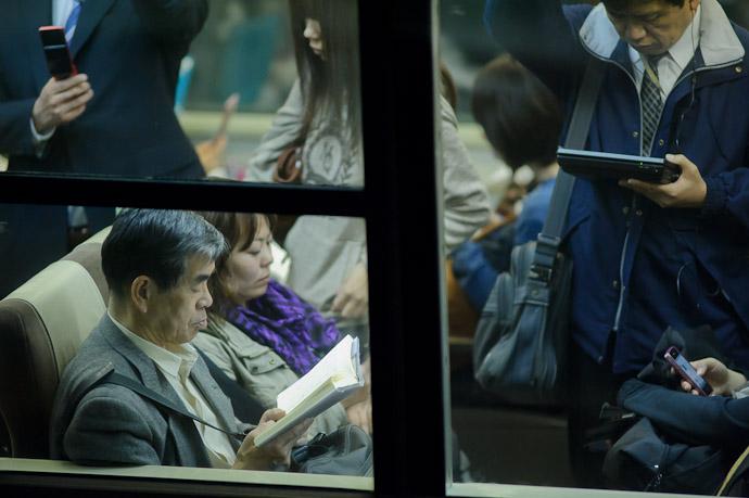 Analog in a sea of digital -- Kyoto Station (京都駅) -- Kyoto, Japan -- Copyright 2011 Jeffrey Friedl, http://regex.info/blog/