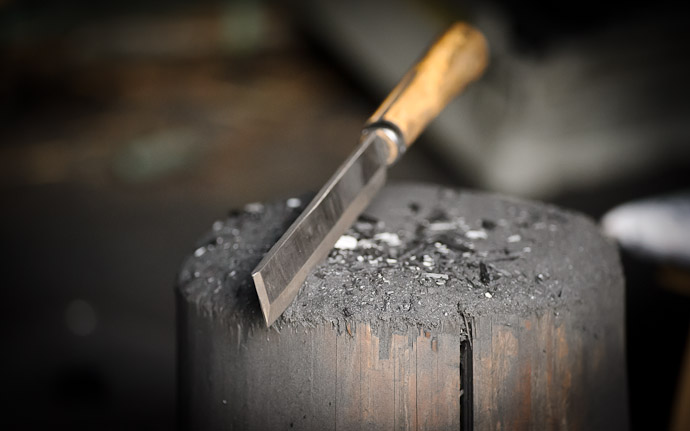 knife and chopping block for cutting charcoal, at a swordsmith's smithy in Wakayama Japan
