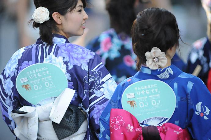 Fan Girls they were distributing paper fans adorned with advertisements -- Gion Matsuri (祇園祭) -- Kyoto, Japan -- Copyright 2011 Jeffrey Friedl, http://regex.info/blog/