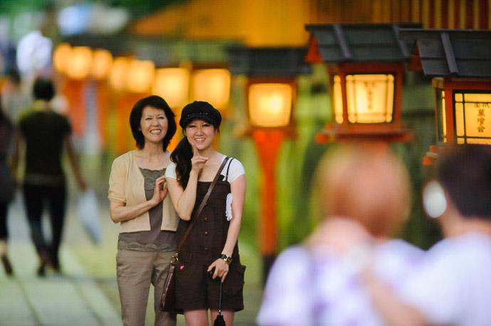 Mother & Daughter were intrigued by my big lens at Gion Matsuri Shinkousai (祇園祭、 神幸祭), Kyoto Japan  --  Gion Matsuri Shinkousai  (祇園祭、神幸祭)  --  Copyright 2011 Jeffrey Friedl, http://regex.info/blog/