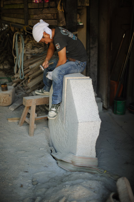 Getting On Top of His Work Apprentice at Nishimura Stone Lanterns -- Nishimura Stone Lanterns (西村石灯籠) -- Kyoto, Japan -- Copyright 2011 Jeffrey Friedl, http://regex.info/blog/ -- This photo is licensed to the public under the Creative Commons Attribution-NonCommercial 3.0 Unported License http://creativecommons.org/licenses/by-nc/3.0/ (non-commercial use is freely allowed if proper attribution is given, including a link back to this page on http://regex.info/ when used online)