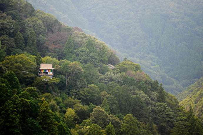 Isolated Temple across the river ( here ), as seen from an observation platform partway up the mountain -- Arashiyama (嵐山) -- Kyoto, Japan -- Copyright 2011 Jeffrey Friedl, http://regex.info/blog/