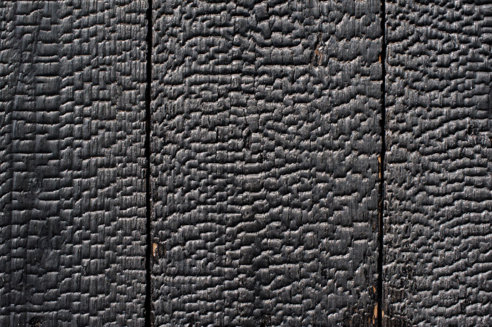 wood siding purposfully burnt to charcoal