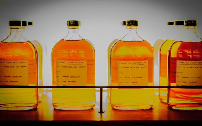 desktop background image of bottles of whisky and spirits at the Suntory Yamazaki Whisky Distillery Whisky Museum near Kyoto Japan  --  Glowy getting a bit funky with an over-exposed shot  --  Suntory Whisky Yamazaki Distillery  --  Yamazaki (Shimamoto), Osaka, Japan  --  Copyright 2012 Jeffrey Friedl, http://regex.info/blog/  --  This photo is licensed to the public under the Creative Commons Attribution-NonCommercial 3.0 Unported License http://creativecommons.org/licenses/by-nc/3.0/ (non-commercial use is freely allowed if proper attribution is given, including a link back to this page on http://regex.info/ when used online)