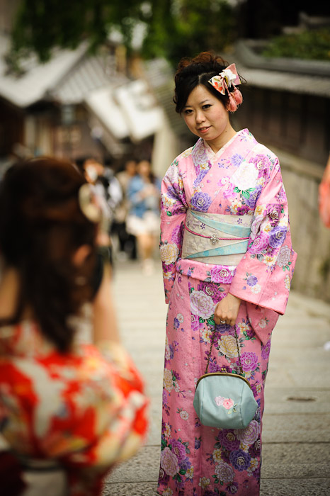 Photo Op while she hides an SLR behind her  --  Kyoto, Japan  --  Copyright 2012 Jeffrey Friedl, http://regex.info/blog/