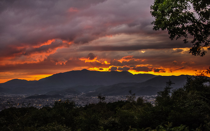 desktop background image of a dynamic sunset over Kyoto, Japan, as seen from the Shogunzuka overlook (将軍塚からの京都の夕焼け)  --  After the Typhoon Tumultuous Sunset Over Kyoto 京都の夕焼け、東山の将軍塚から  --  Shogunzuka (将軍塚)  --  Copyright 2012 Jeffrey Friedl, http://regex.info/blog/