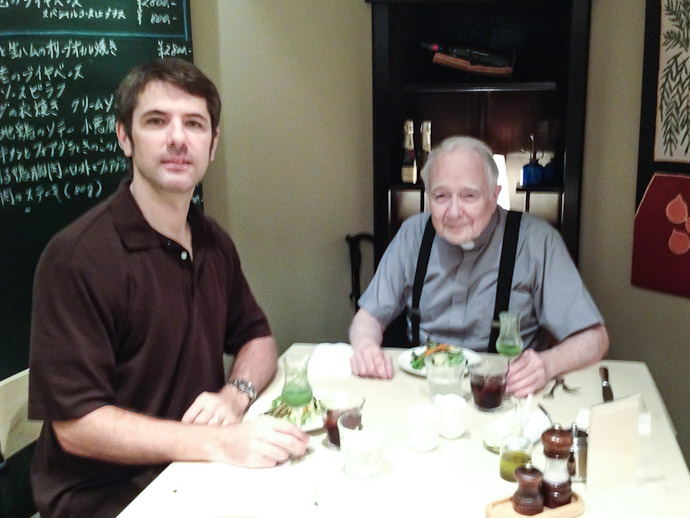 Me with Fr. Graham McDonnell on the 54th anniversary of his ordination ( as we stare at an iPhone in the unconfident hands of a waitress )  --  Restaurant Normandie (ノルマンディ)  --  Kyoto, Japan