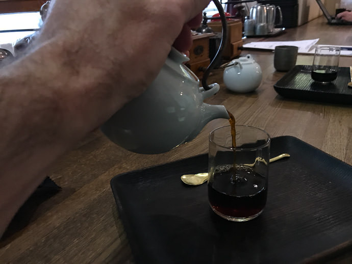 Trying the Weak Coffee -- Kafe Kosen (KAFE工船) -- Kyoto, Japan -- Copyright 2018 Jeffrey Friedl, http://regex.info/blog/ -- This photo is licensed to the public under the Creative Commons Attribution-NonCommercial 4.0 International License http://creativecommons.org/licenses/by-nc/4.0/ (non-commercial use is freely allowed if proper attribution is given, including a link back to this page on http://regex.info/ when used online)