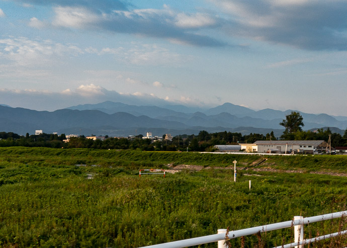 First Sight of the Goal I think that's Mr. Norikura to the right of center, 65km (40 mi) away -- Toyama, Japan -- Copyright 2018 Jeffrey Friedl, http://regex.info/blog/