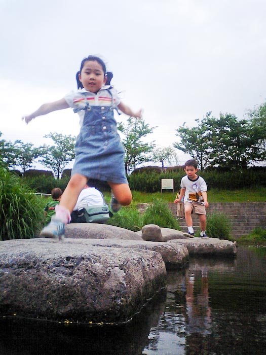 Akiko-chan and Anthony Hopping Rocks Stepping stones across the Kamo and Takano Rivers, Kyoto Japan -- Copyright 2008 Jeffrey Eric Francis Friedl, http://regex.info/blog/