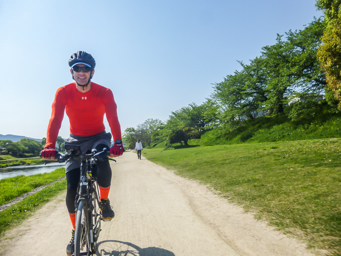 Happy at the Start of a Long Ride along the Kamo River in Kyoto, Japan 8:51am - taken while moving at 20 kph (12 mph) photo by Manseki Kanemitsu -- Copyright 2015 Manseki Kanemitsu