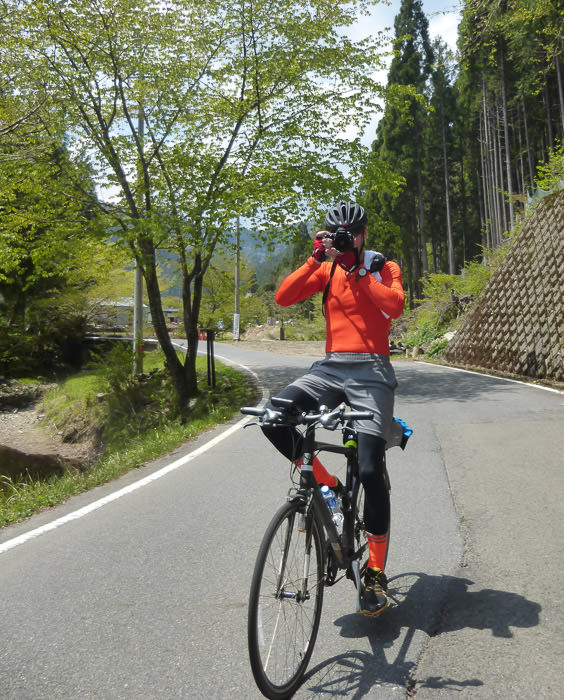 """ Action Shot "" of Me how I take photos while riding on smooth terrain 12:21pm - taken while moving at 16 kph (10 mph) photo by Manseki Kanemitsu -- Kyoto, Japan -- Copyright 2015 Manseki Kanemitsu"