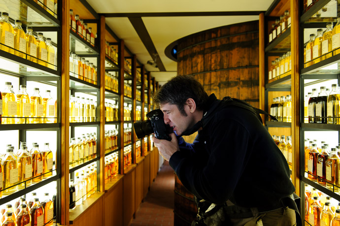 """7,000 Bottles of Beer on the Wall..."" me, photographing samples of whisky (not beer, that was here ) at the Suntory Whisky Distillery (スントリー 山崎 ウイスキー 工場) in Yamazaki Japan photo by Paul Barr  --  Suntory Whisky Yamazaki Distillery  --  Yamazaki (Shimamoto), Osaka, Japan  --  Copyright 2012 Paul Barr"