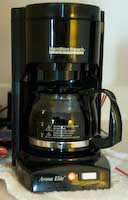 The poorly-designed Hamilton Beach Aroma Elite cofee maker that    tends to spill its coffee all over the floor, at the Sheraton Suites    hotel, Cuyahoga Falls, Ohio