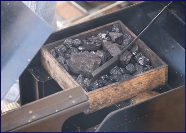 Coal ready to feed a mini steam locomotive