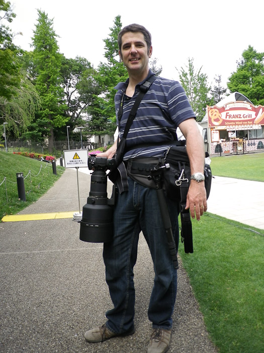 Behind Tokyo Midtown trying to stand such that the big silver lens case is hidden behind me Photo by Nice Lady in Tokyo -- Minato Ward, Tokyo, Japan