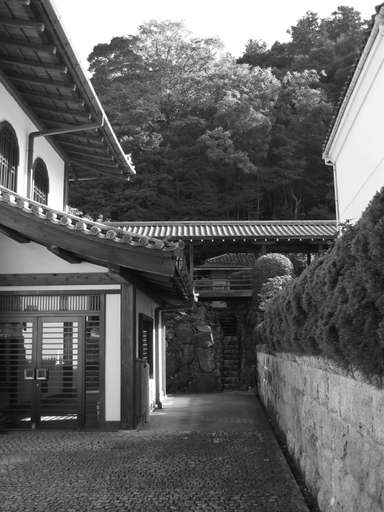 elevated walkway spanning a narrow stone stairwell, at the Nanzen Temple (Nanzenji) in Kyoto, Japan