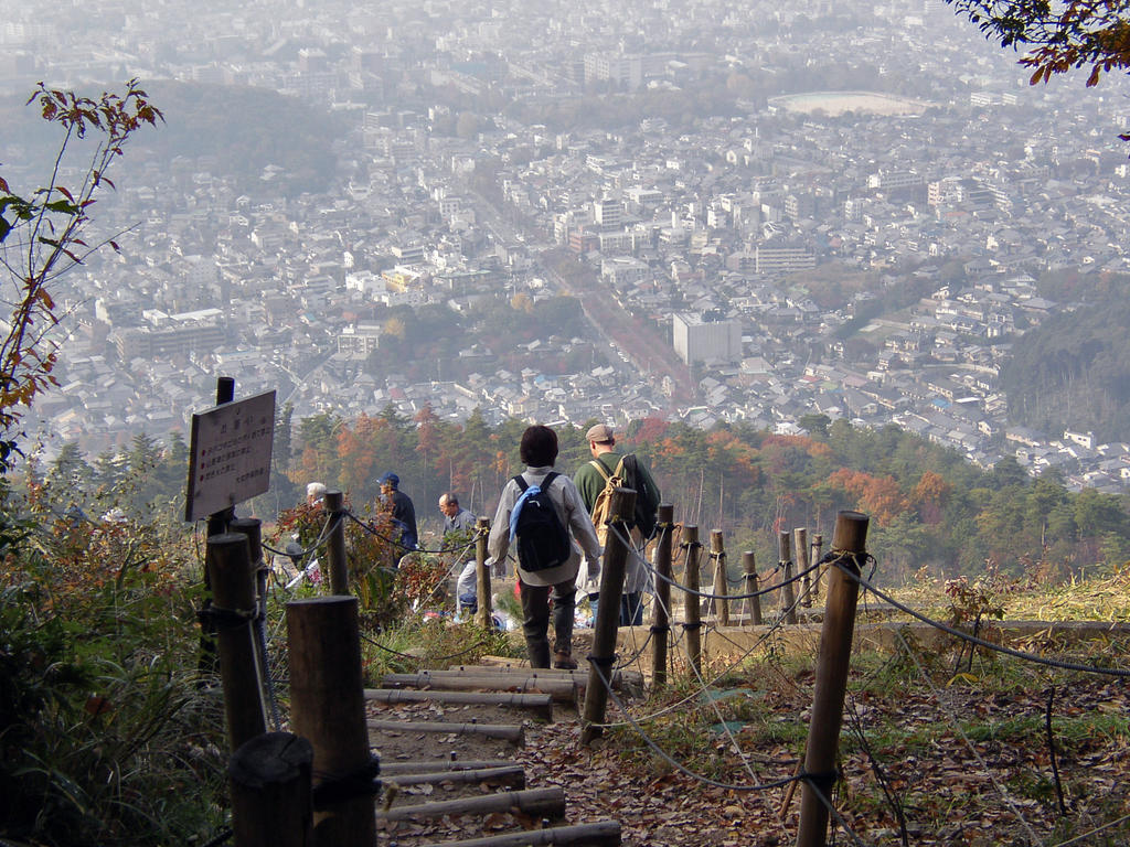 Exiting the Forest onto the Hidokoro (fire-burning area) of Mt. Daimonji, Kyoto Japan. Photo by Katsunori Shimada