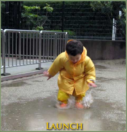 Anthony launching into a big jump... into a puddle