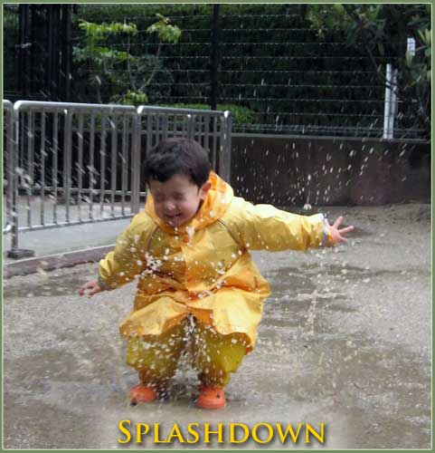 Anthony landing in a puddle with a spalsh